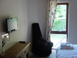 All bedrooms are equipped with flat-screen televisions