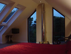 The master bedroom has windows which look out upon the St Magnus Cathedral spire