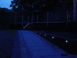 The decking at Kingston House is lit at night